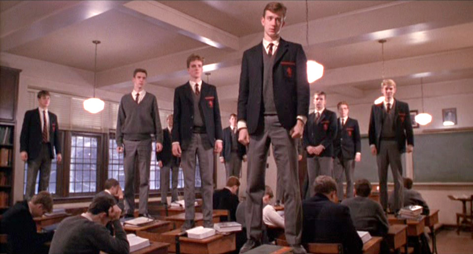Dead Poets Society: Boys stand on their desktops like speechless zombies